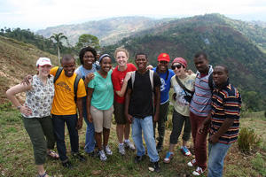 American University Alternative Break students take a picture with University of Fondwa students in Haiti.
