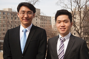 Sun (left) stands beside Kubota, both in suits.