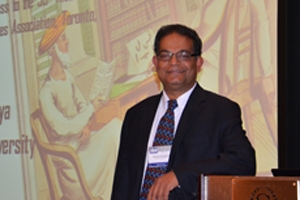 Dr. Acharya addresses the ISA