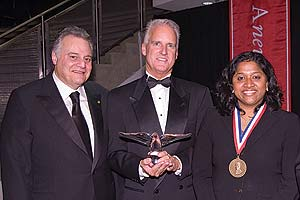 Gary Abramson, SPA/BA '68, chairman of the Board of Trustees, stands at left with President's Award recipient Jack Cassell and Cyrus Ansary Medal recipient Esther Benjamin