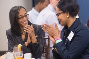SOC alumna Lori Billingsley, left, and Tangela Richardson, SOC/MA '13, talk over lunch before Billingsley's Alumni in the KNOW presentation. Photo by Jeff Watts.