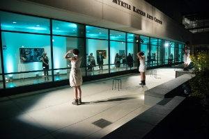 The front of the Katzen Arts Center lit up blue.