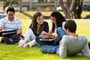 Students outside on a lawn