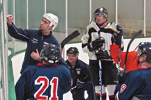 Photo: David Baratta diagrams a play for his USA Warriors hockey team.