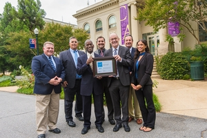 American University staff stand in front of Batelle-Tompkins building with ENERGY STAR certification