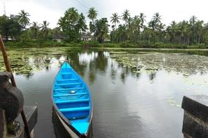 River and blue canoe. Varanga Temple background. Karkala, Karnataka.