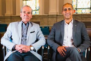 Kogod professors Bob Sicina and Ayman Omar sitting together and smiling.