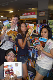 International students with travel books from home countries.