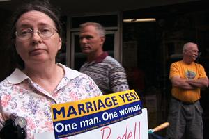 Protesters proclaim marriage is for one man and one woman.