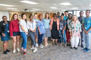 AU President Sylvia Burwell and Cheryl Holcomb-McCoy, dean of AU's School of Education, pose with students.