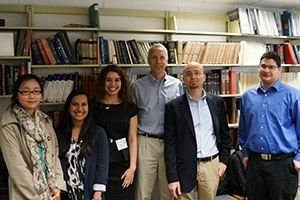 Nobel Laureate Brian Kobilka (center) meeting with AU biochemistry professor Stefano Costanzi and chemistry students at the National Institutes of Health.