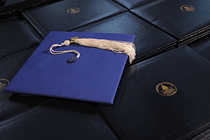 mortarboard and diplomas
