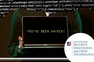 Individual holding a computer reading - you've been hacked, with code in the background.