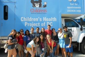 Studnts in front of Children's Health Project of DC bus