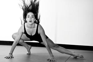 Dancer lunging with hair flying up