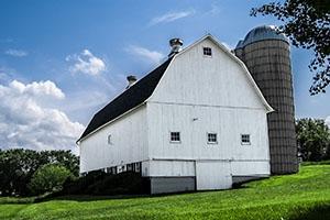 white barn and silo on a farm