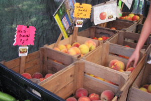 Wooden crates filled with peaches and apples