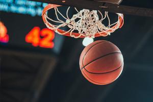 Basketball going through hoop.