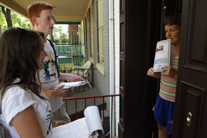 Freshmen assist with a door-to-door community survey during the Freshmen Service event.