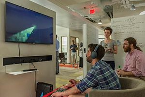 Students playing each other's games at a Game Lab showcase