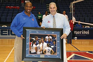 Keith Gill, left, presented volleyball coach Barry Goldberg with a picture to commemorate his 500th carrer win.