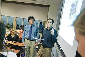 Photo: Sonya Grier, left, watches her students present their research
