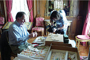 Photo: The film includes the installation of a Sèvres royal table using plates from the 1700s and a royal garden centerpiece made of spun sugar by culinary histo-rian Ivan Day, above left.
