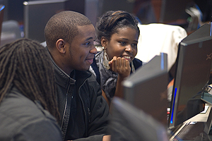 Photo: Brandon Warren and Tamesha Veasley work on the EverFi Financial Literacy Program at the new Kogod School of Business Financial Services and Information Technology Lab.