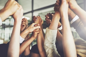 hands uplifted in unity