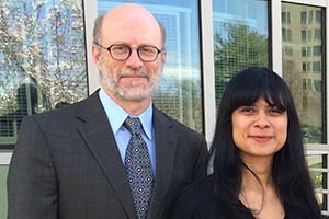 Dean Jeff Rutenbeck and Kara Andrade stand outside