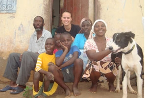 Peace Corps Volunteer Justine Amos '08 in Swaziland with her host family.