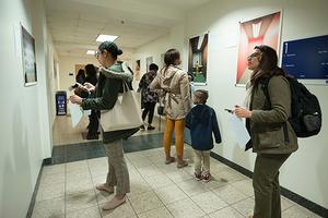 Kerwin Hall visitors peruse Juvenile in Justice photography exhibit