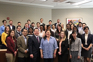 Students presented their marketing plans to Andrew Levine, center, and his wife, Julie.