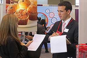 Luis Lizarazo, MBA '12, speaks with an attendee at the NSHMBA 2010 conference in Chicago.