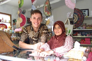 Wyatt Gordon, SIS/BA '12 in Indonesia, pictured with a woman wearing a head scarf.