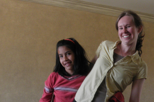 Meghan Meros dancing with a girl at the orphanage.