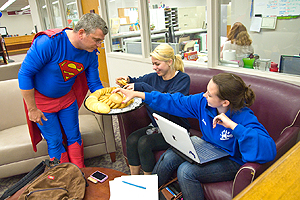 Photo - University librarian Bill Mayer, dressed as Superman, offers up cookies to students.