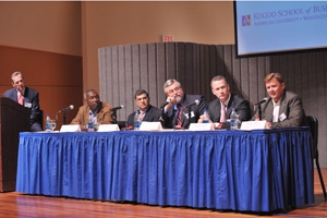 Professor Robert Sicina and panelists Roy Dunbar, Shiv Krishnan, William