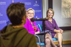 Maria Elena Salinas and Jane Hall on stage during a screening of Risking it All taking a question from a student.