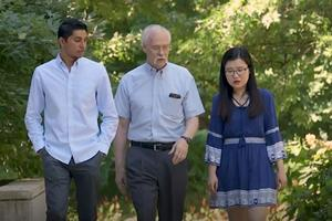 Ken Meier walking with students
