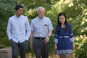 Ken Meier walking with students