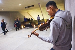 Musician Raycurt Johnson plays for the commuters at D.C.'s Metro station at L'Enfant Plaza. (Photo: Jeff Watts)