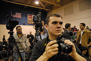 A 2008 NH primary class participant snaps photos alongside national media.