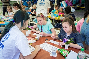 Teen girls in Zaporizhia, Ukraine participate at a calligraphy workshop
