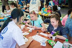 Teen girls in Zaporizhia, Ukraine participate at a calligraphy workshop