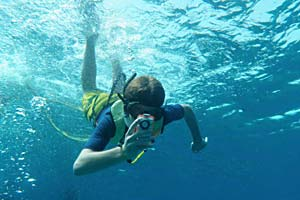 High school student filming underwater