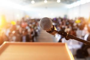 A microphone at a podium in front of a lecture hall