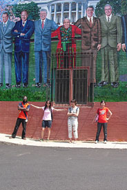 Students infront of a colorful Adams Morgan mural