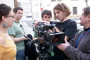 Students participating in the FAMU international film program in Prague shoot a street scene