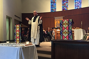A Catholic chaplain speaks at an interfaith service.